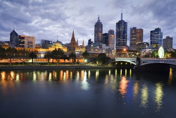 Australia, Victoria, Melbourne. Yarra River and city skyline by night
