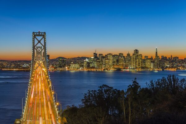 Dusk view over Bay Bridge and downtown skyline from Yerba Buena Island, San Francisco, California, USA