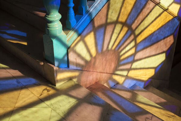 Light falling through stained glass window, in a Casa in Habana Vieja, Havana, Cuba