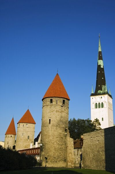Lower Town City Wall Towers and St Olav Church, Located in the Unesco World Heritage Old Town The 13th Century St Olav Church at 124m was once the tallest building in the world The Baltic States, Estonia, Tallinn, Lower Town City Wall Towers and S