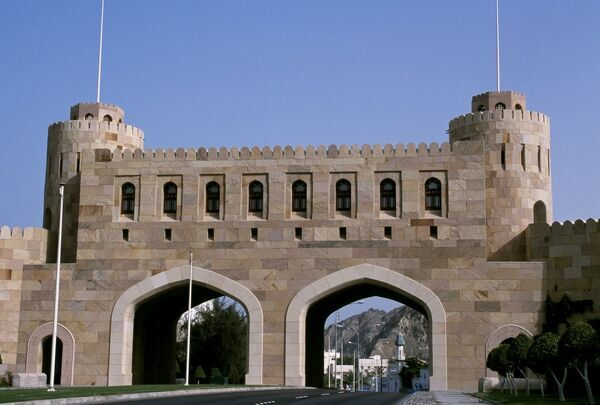 The Mathaib Gate spans the main road into Muscat