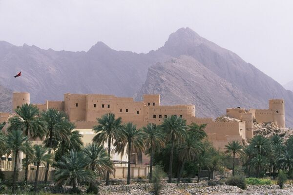 Nakhl Fort stands in the foothills of the Western Hajar Mountains. The early foundations are thought to pre-date Islam. The mainly 17th century fortress visible today stands over 30 metres high and covers 3, 400 square metres