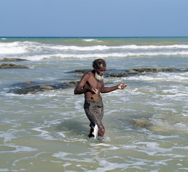 An old fisherman brings in his catch at Apallhen Beach, which is an important turtle breeding ground in the north of the island