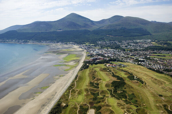 The Royal County Down golf course with the Slieve Donard Hotel, the small coastal town of Newcastle and the Mountains of Mourne behind