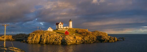 USA, Maine, York Beach, Nubble Light Lighthouse with Christmas decorations, sunset