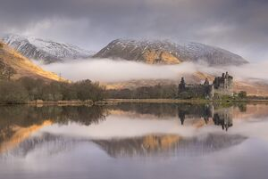 The abandoned ruin of Kilchurn Castle on a misty winter morning, Loch Awe, Argyll & Bute