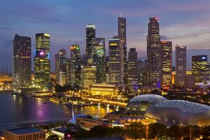 Asia, Singapore, Singapore Skyline Financial district illuminated at dusk