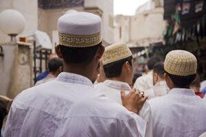 Boys make their way to the Sayyida Ruqayya Mosque in the Old City