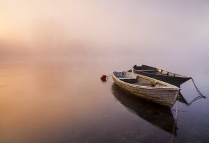 Brivio, Lombardy, Italy. Two boats on the Adda river at sunrise