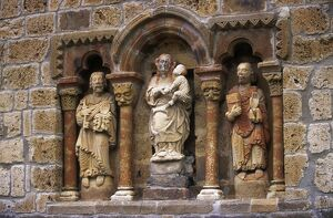 Detail of carved stone figures on the XIIth C Romanesque