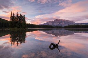 Colourful dawn sky above Mount Rundle and Two Jack Lake, Banff National Park, Alberta