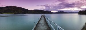 Dusk falls over picturesque wharf in idyllic Kenepuru Sound, Marlborough Sounds
