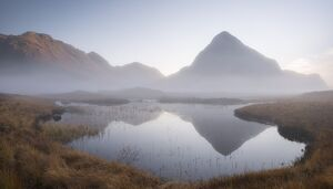 Evening mist shrouds Buachaille Etive Beag mountain on Rannoch Moor, Highland, Scotland