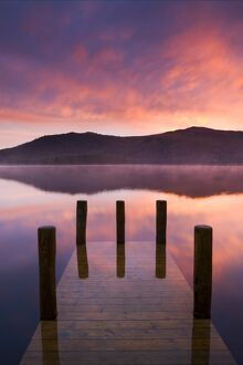 Fiery sunrise over Derwent Water from Hawes End jetty, Lake District National Park
