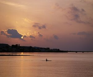 A fishermen paddles his small boat across Tadjoura Bay at sunrise