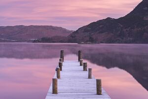 Frosty jetty on Ullswater at dawn, Lake District, Cumbria, England. Winter (November)