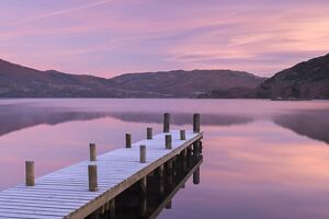 Frosty wooden jetty on Ullswater at dawn, Lake District, Cumbria, England. Winter