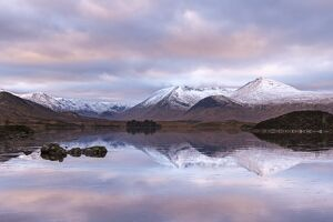 Frozen Lochan na h-Achlaise and snow covered Black Mount mountain range, Rannoch Moor