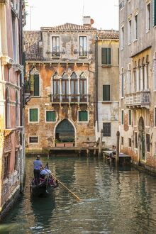 Gondola on canal in Venice, Veneto, Italy