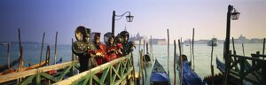 Gondolas & people in Carnival costumes, Piazza San Marco (St