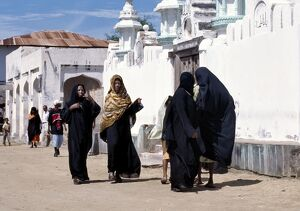 A group of Swahili women clad in black to signify their