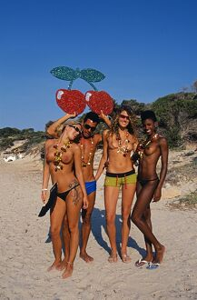 Happy people on the beach in Ibiza