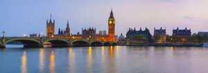 The Houses of Parliament & The River Thames illuminated at dusk