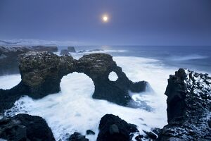Iceland, characteristic cliff overlooking the sea, illuminated by the moonlight