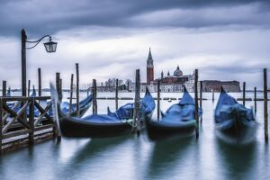 Italy, Veneto, Venice. Gondolas at dawn with San Giorgio Maggiore church on the background