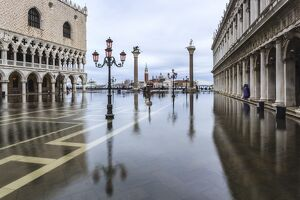 Italy, Veneto, Venice. High water on San Marco Square with Palazzo Ducale on the left