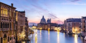Italy, Veneto, Venice. Santa Maria della Salute church and Grand Canal at sunrise