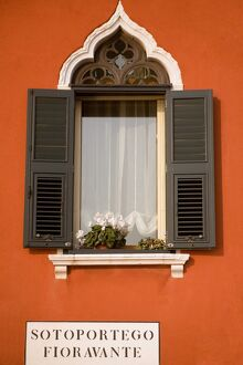 Italy, Veneto, Venice; A typical Ventian window with 'persiane' - shutters