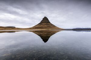 Kirkjufell Mountain reflects itself on the Atlantic waters in Snaefellsnes peninsula