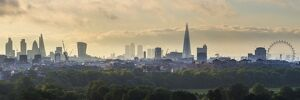 London skyline with the Shard above Hyde Park, London, England, UK