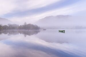 Misty autumn morning on Ullswater in the Lake District, Cumbria, England. Autumn