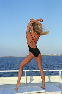 Model posing on the deck of a ferry