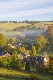 Naunton village and morning mist, Naunton, Gloucestershire, Cotswolds, UK