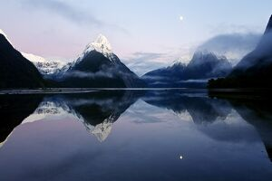 New Zealand, Nuova Zelanda, Fiordland, Milford Sound and moon during a cold and misty