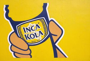 A painted sign for Inca Kola