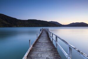 Picturesque wharf illuminated at dusk, Kenepuru Sound, Marlborough Sounds, South Island
