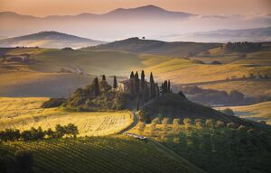 Podere Belvedere, San Quirico d'Orcia, Tuscany, Italy. Sunrise over the farmhouse