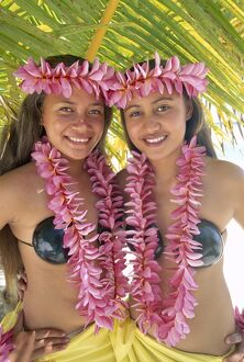 Polynesian Girls Dressed in Traditional Costume with Leis