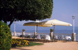 Promenade at Gardone Riviera with tables and chairs