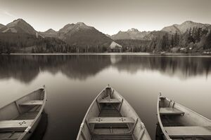 Rowing boats and mountains beneath a twilight sky, Strbske Pleso Lake in the High Tatras