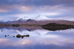 Snow Covered Black Mount reflected in a lochan, Rannoch Moor, Highland, Scotland