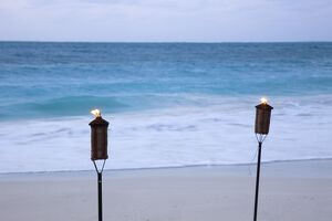 Torches on beach, Grace Bay, Providenciales, Turks and Caicos