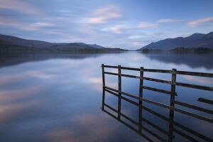 Tranquil Derwent Water at dusk, Lake District, Cumbria, England. Autumn (October)