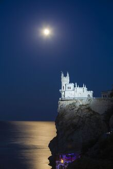 Ukraine, Crimea, Yalta, Gaspra, Full moon over shines over The Swallow's Nest castle