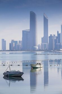 United Arab Emirates, Abu Dhabi, View of City skyline reflecting in Persian Gulf