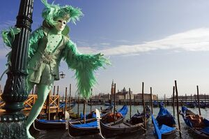 Venice Carnival People in Costumes and Masks on Canal